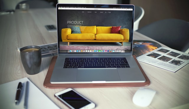 laptop displaying the home page of an online store, online store mobile app development service